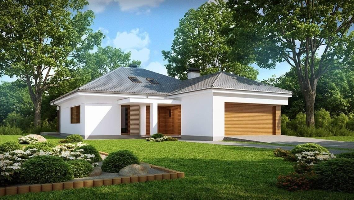 Проект одноповерхового класичного котеджу з гаражем і мансардою