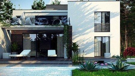 Проект невеликого сучасного двоповерхового будинку з терасою на другому поверсі
