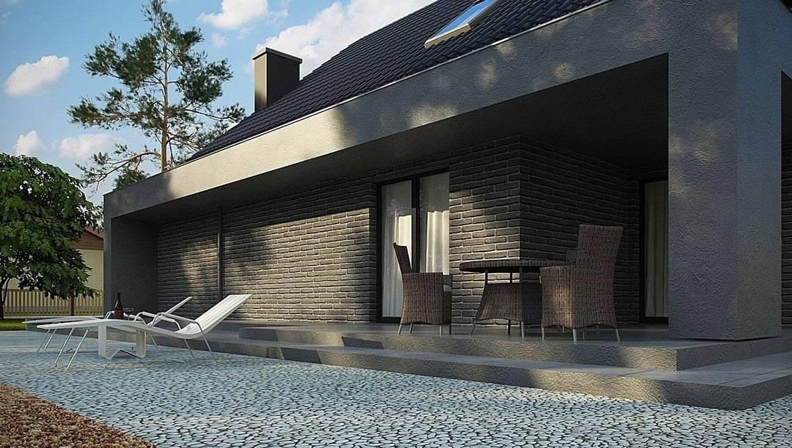 Проект цікавого котеджу з великою терасою над гаражем