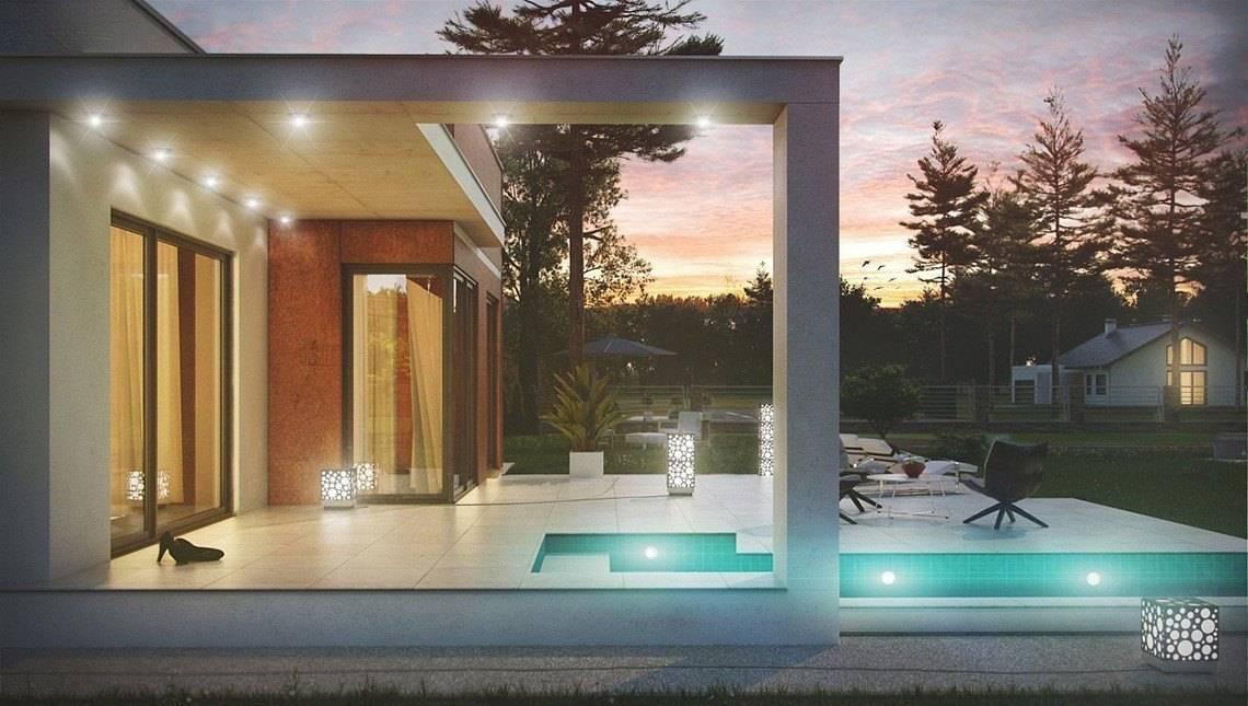 Проект сучасного котеджу з плоским дахом і гаражем для двох авто