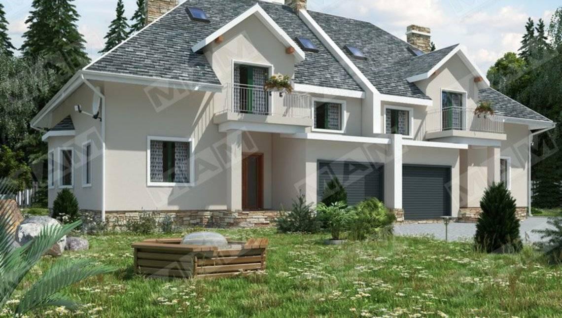 Проект просторого комфортного котеджу на 2 сім'ї з гаражем