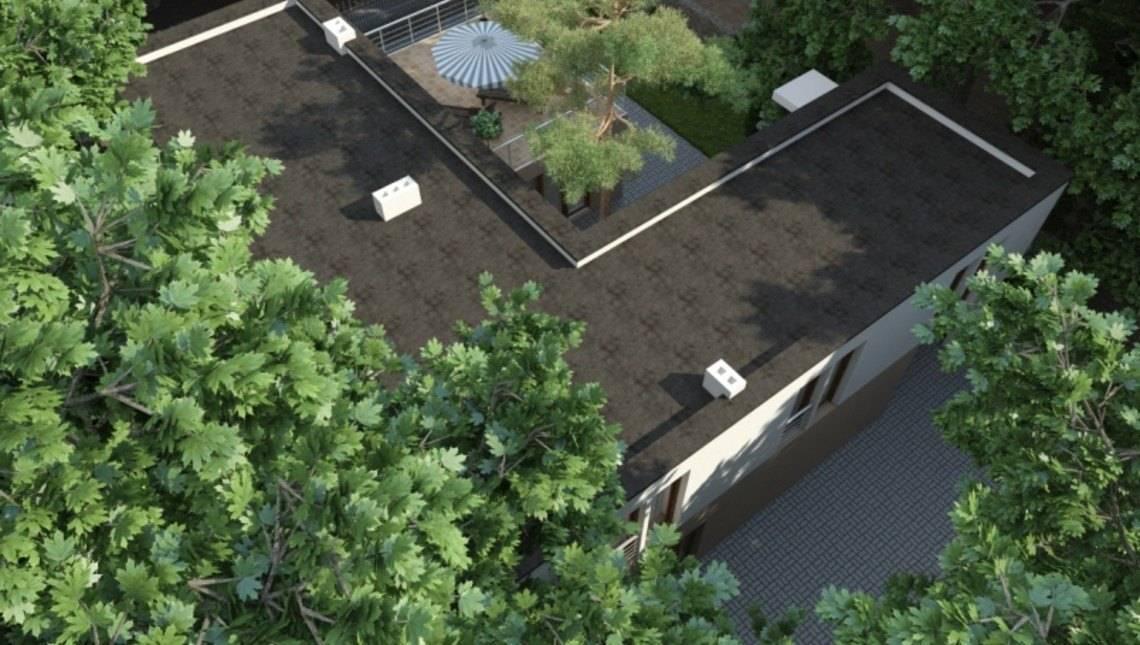 Сучасний котедж Г-подібної форми з внутрішнім двориком