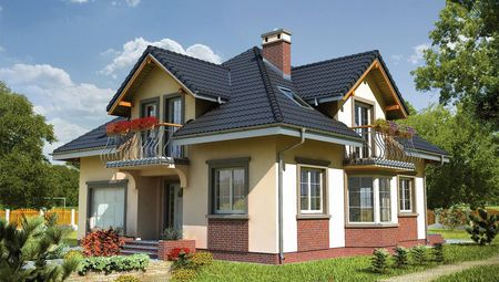 Проект будівництва симпатичного мансардного будинку з еркером